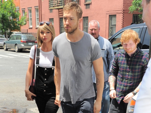 Taylor Swift and Calvin Harris are photobombed by Ed Sheeran in New York