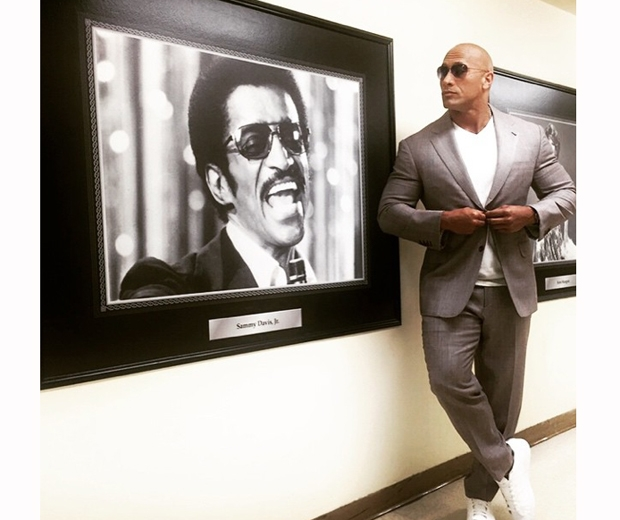 the rock instagram in a grey suit and sunglasses
