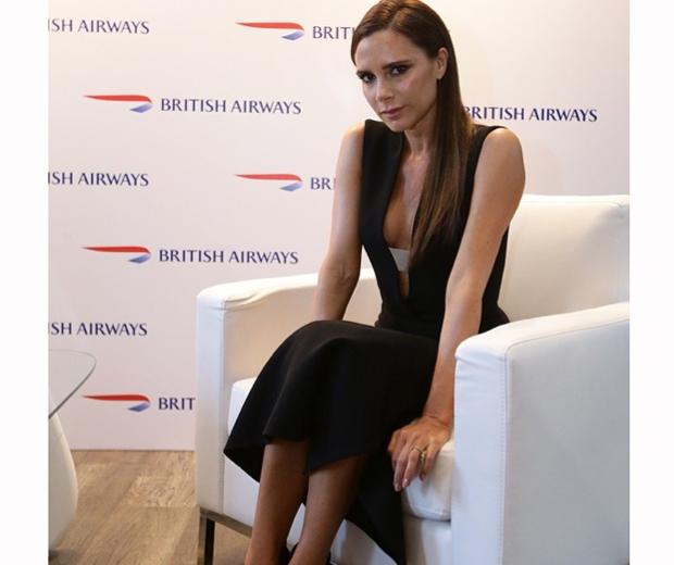 victoria beckham in a plunging black dress at british airways