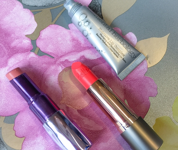 Urban Decay, Delilah and Elemental Herbology lip treats are always in Sam's bag