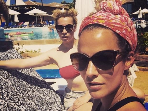Caroline Flack showing off her tan in Instagram selfie