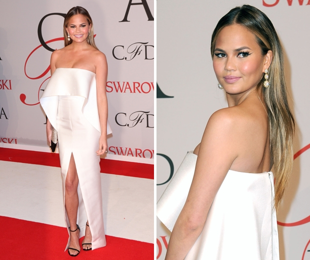 Chrissy Teigen stunned in a crisp white Solace London gown at the CFDA Awards