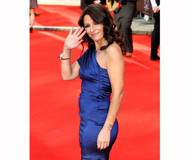 davina mccall in blue satin dress on red carpet