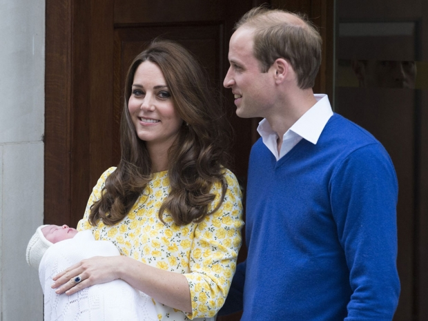 Kate Middleton and Prince William with baby Princess Charlotte