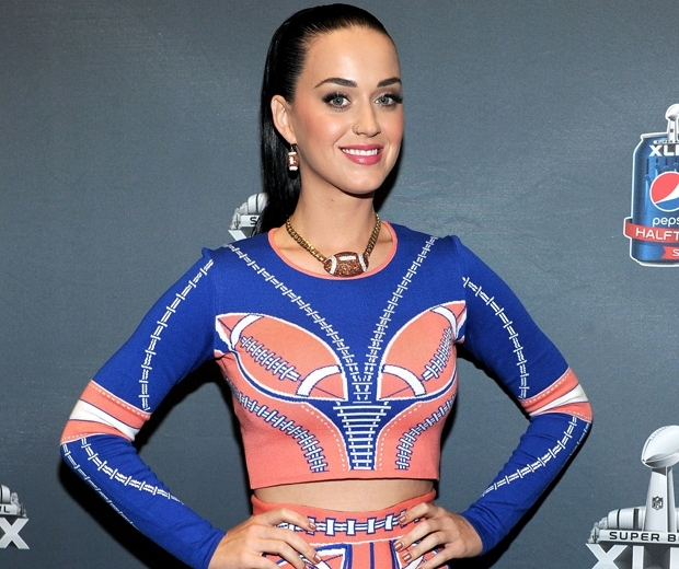 katy perry in blue and pink dress with slicked back ponytail