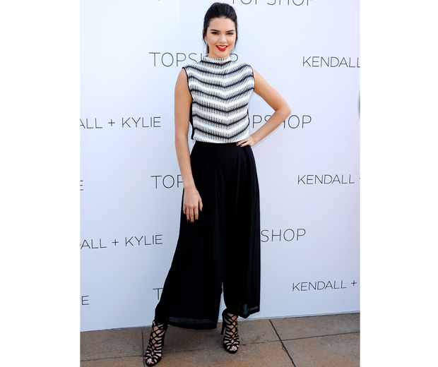 Kendall Jenner worked Topshop wide-leg trousers and a graphic stripe top
