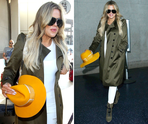 khloe kardashian with white jeans and green mac with bright orange hat