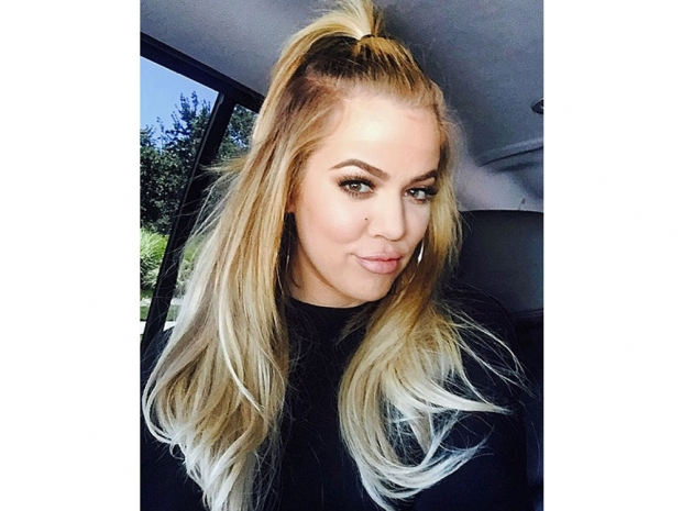 Khloe Kardashian showing off her half-up hairdo on Instagram