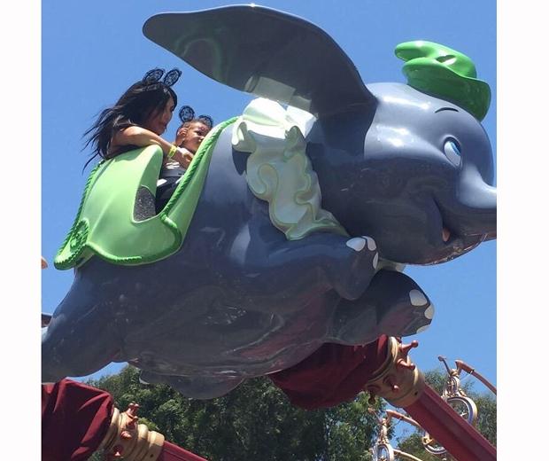 Kim Kardashian and North ride Dumbo at Disneyland