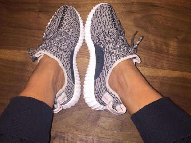 Kim Kardashian shows off her Kanye West adidas trainers on Twitter