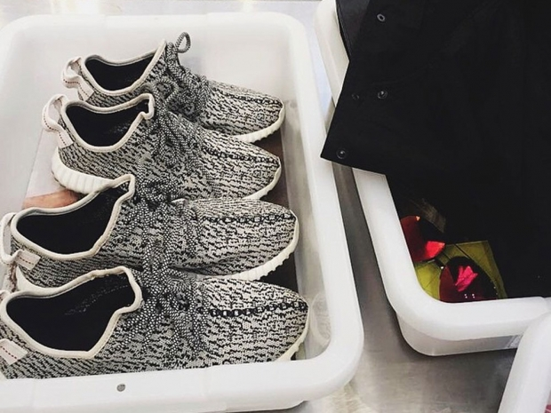 Kylie Jenner and Tyga's Kanye West adidas trainers in security tray on Instagram