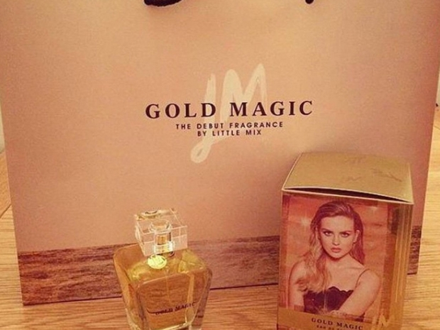 A bottle of Little Mix's Gold Magic perfume