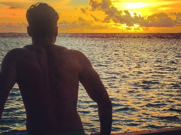 Mark Wright poses by a sunset on honeymoon in Instagram photo