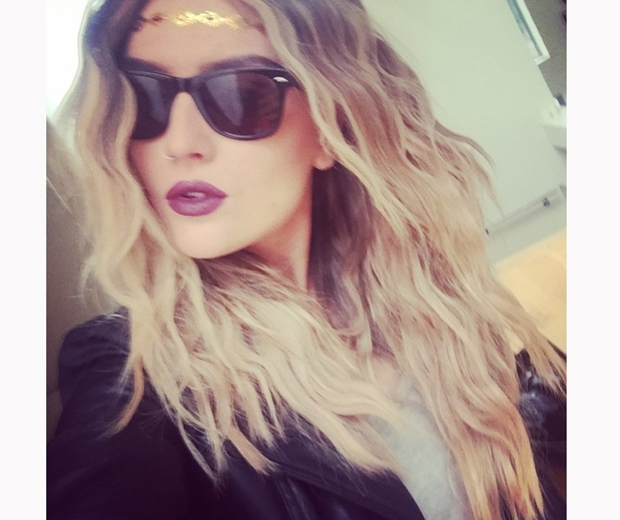 Perrie Edwards with a gold temporary tattoo on her head in Instagram photo