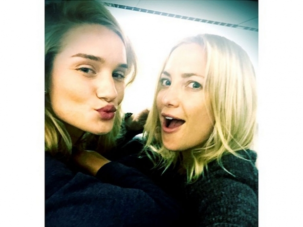 Kate Hudson and Rosie Huntington-Whiteley on a flight.