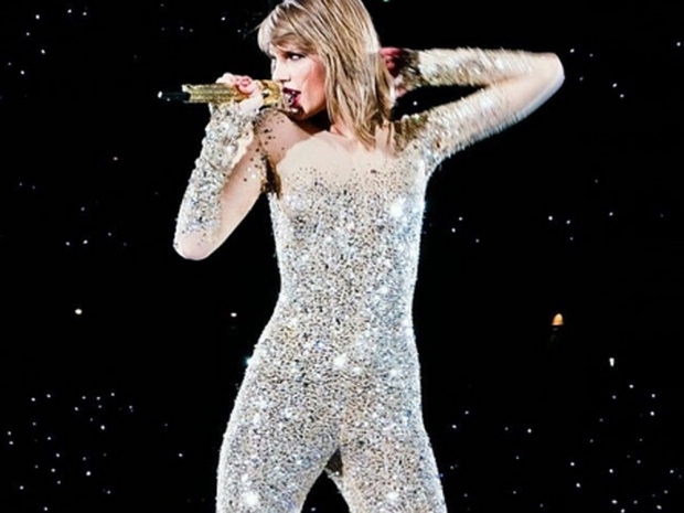 Taylor Swift dazzles in a glittery bodysuit whilst performing on tour