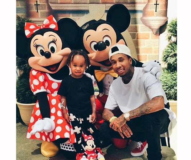 tyga with daughter at north west's disney birthday party
