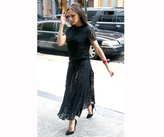 Victoria Beckham in sheer lace pleated skirt and laace sleeve t-shirt