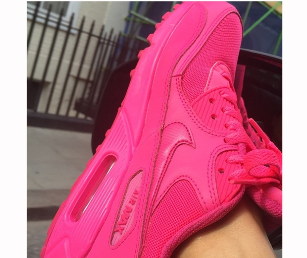 Victoria Beckham shows off her hot pink Nike Air trainers