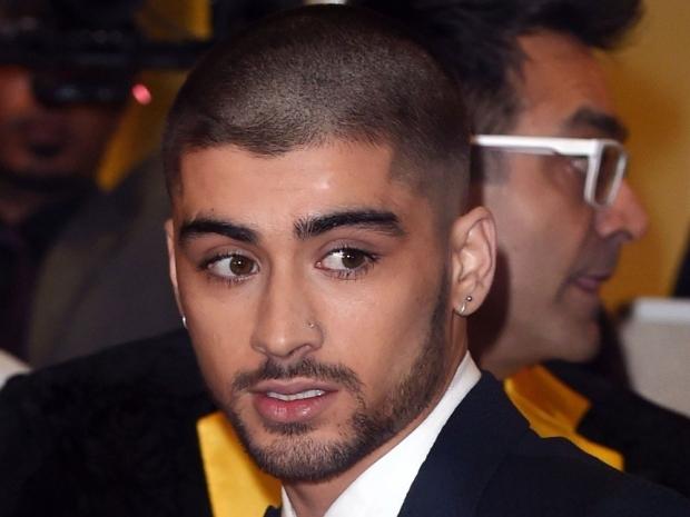 Zayn Malik shows off his shaved head