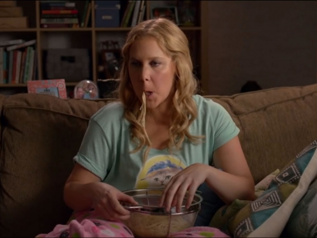 Amy eating a bowl of spaghetti in another sketch from Inside Amy Schumer