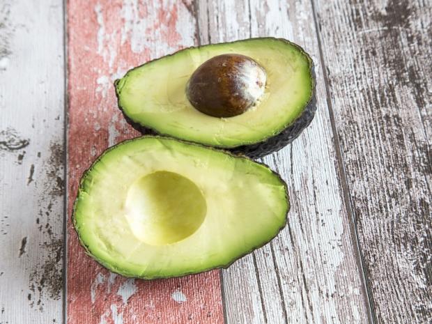 An avocado on a bench