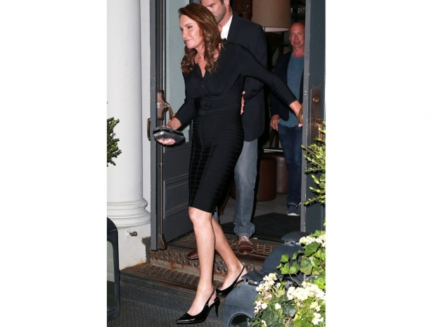 Caitlyn Jenner showing off her black slingback heels