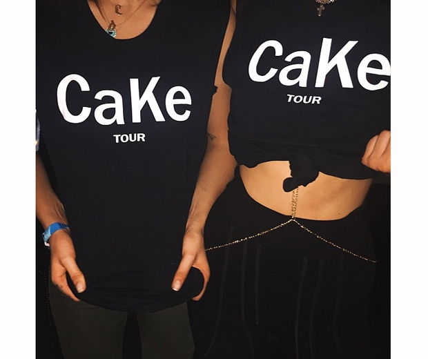 Kendall and Cara show off their custom-made CaKe t-shirts at Glastonbury