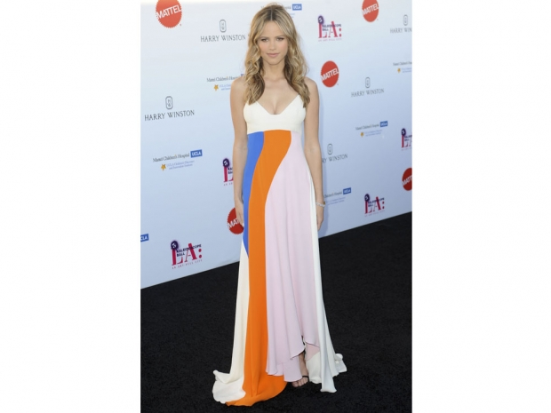 Halston Sage wearing Dior on the red carpet.