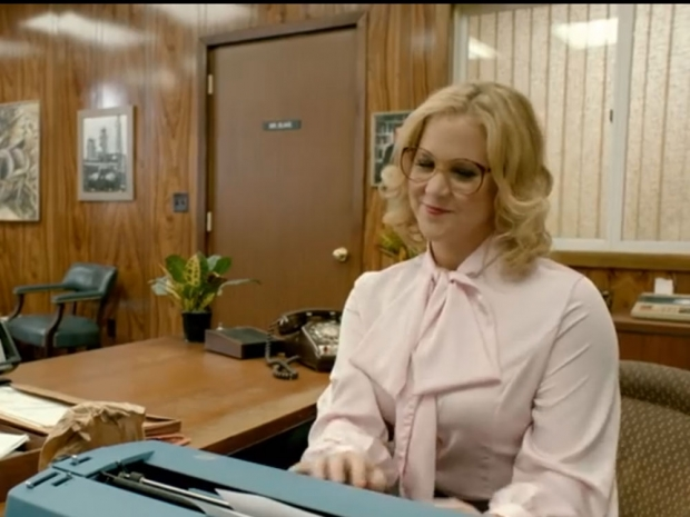 Amy Schumer at her desk in a new sketch from her own show, Inside Amy Schumer