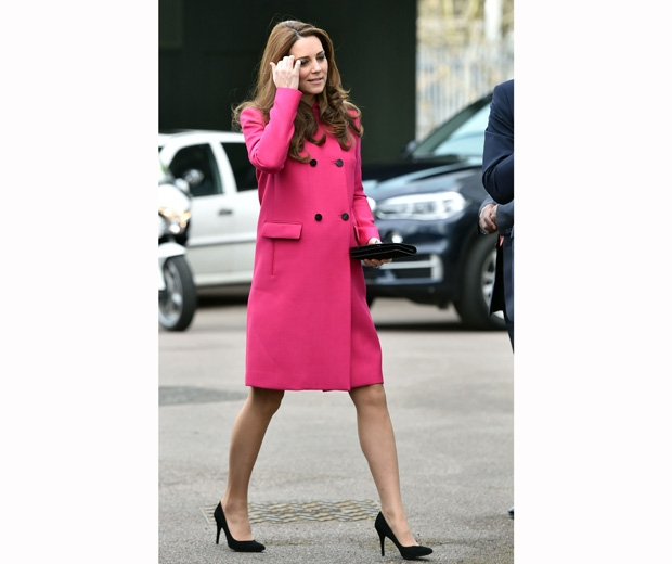 kate middleton in a pink coat and court shoes