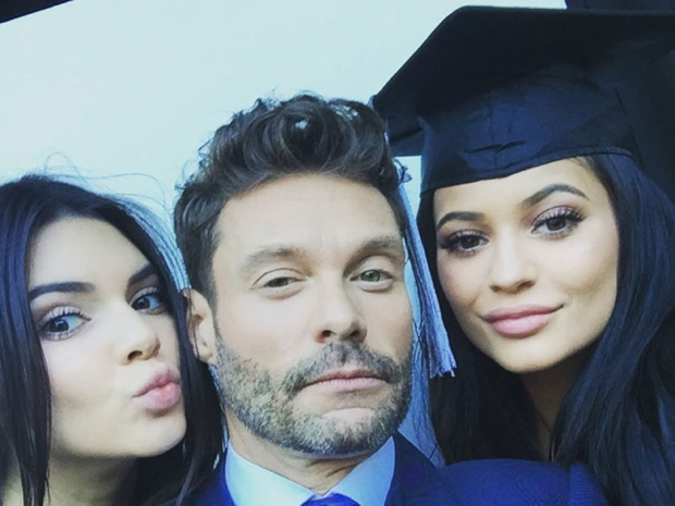 Ryan Seacrest with Kendall and Kylie Jenner at their graduation ceremony