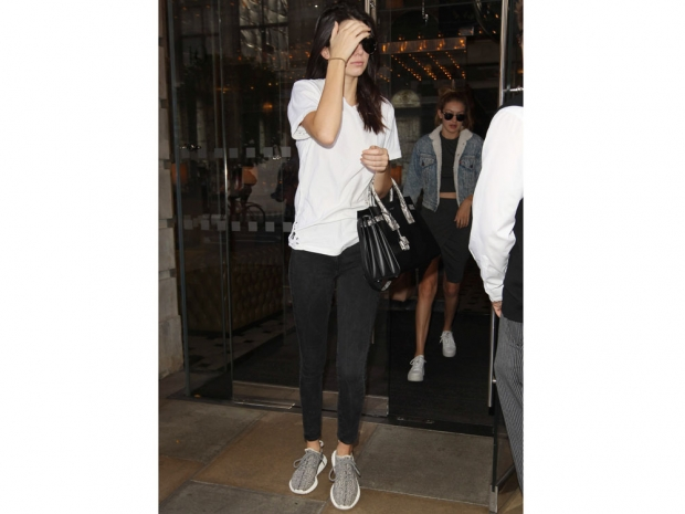 Kendall Jenner wearing a white T-shirt and dark jeans in London