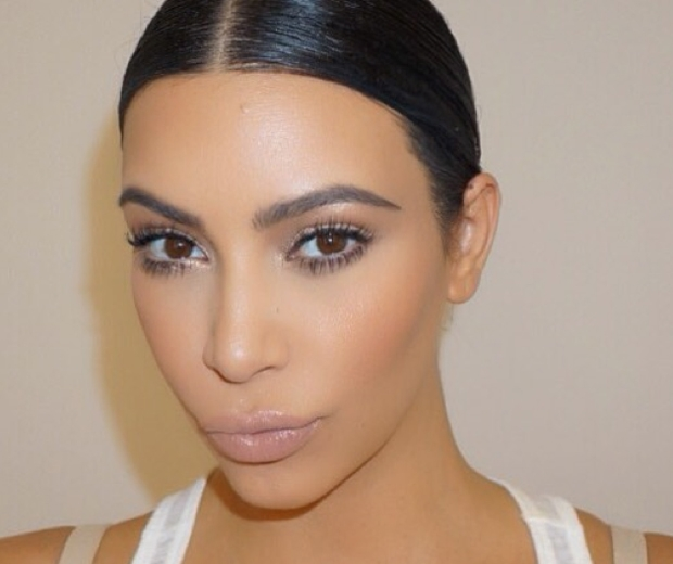 kim kardashian with hair slicked back and a smokey eye