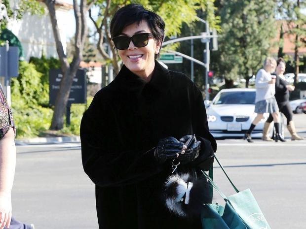 Kris Jenner wearing a black coat