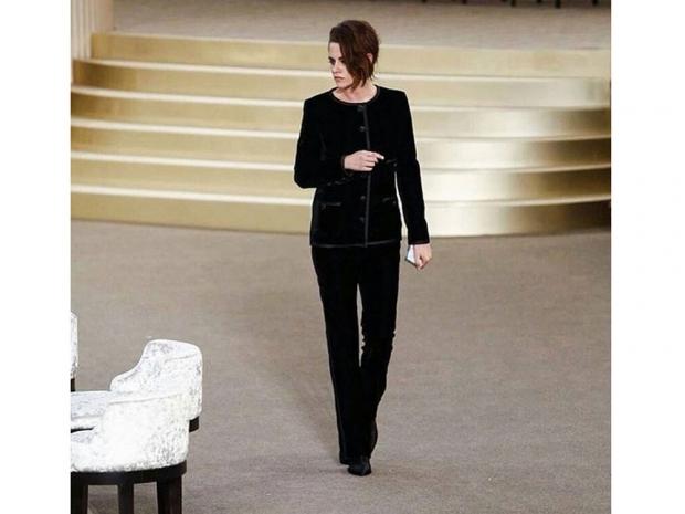 Kristen Stewart walking the catwalk.