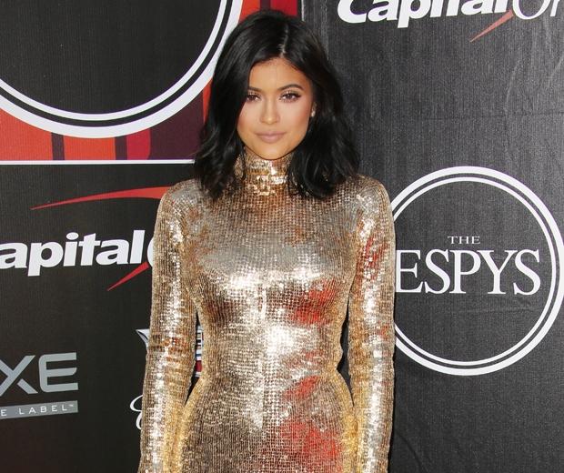 kylie jenner in a gold sequin Shady Zeineldin dress