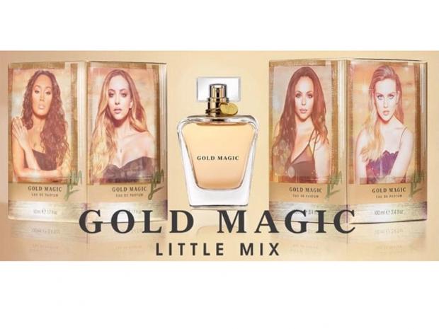 An advert for Little Mix's perfume Gold Magic