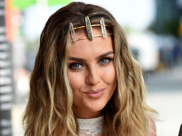 Perrie Edwards wearing a dramatic headband in Manchester