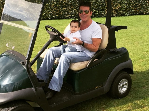 Simon Cowell and son Eric on The X Factor set