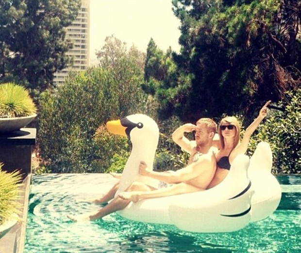 taylor swift and calvin harris riding a swan on instagram