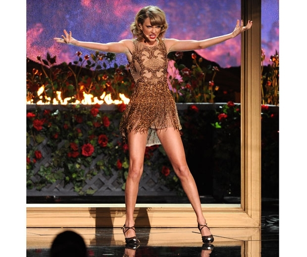 taylor swift in gold tassel dress on stage
