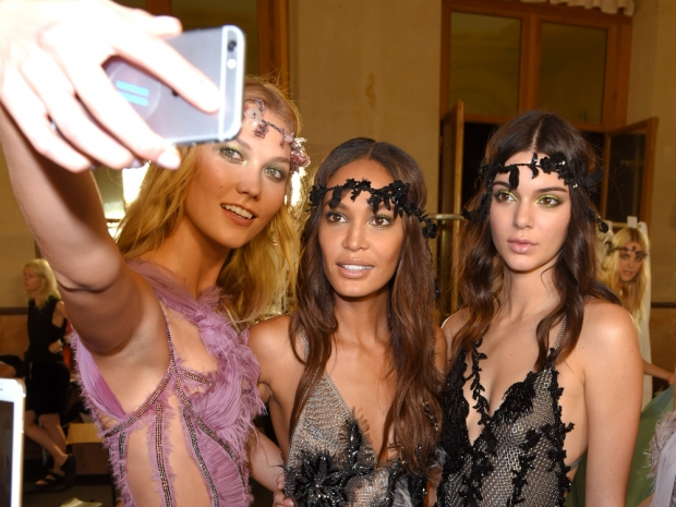 Karlie Kloss, Joan Smalls and Kendall Jenner take a selfie backstage at Versace