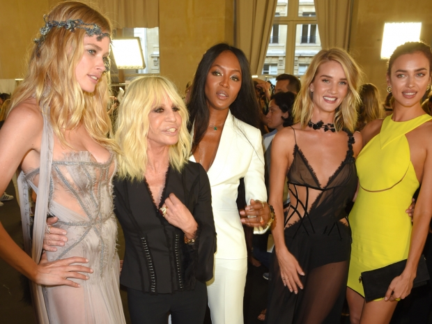 Donatella Versace poses with Naomi Campbell and Rosie Huntington-Whiteley