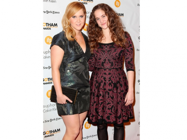 Amy Schumer and her sister Kim Caramele pose on the red carpet together
