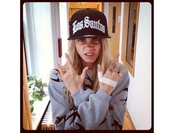 Cara Delevingne poses in her Los Santos Hat