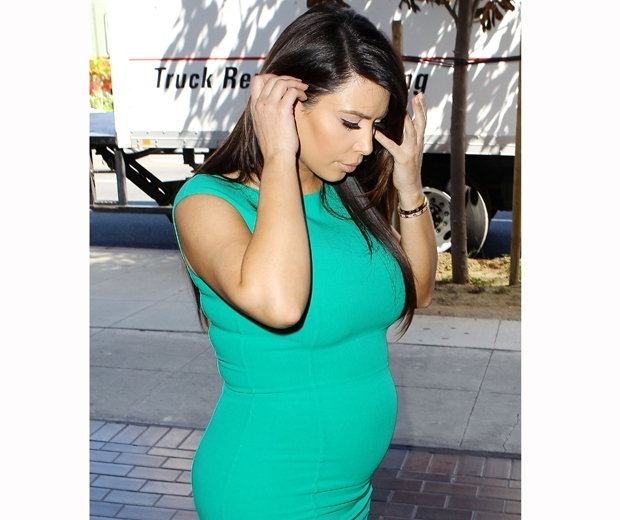 kim kardashian pregnant in a turquoise green dress
