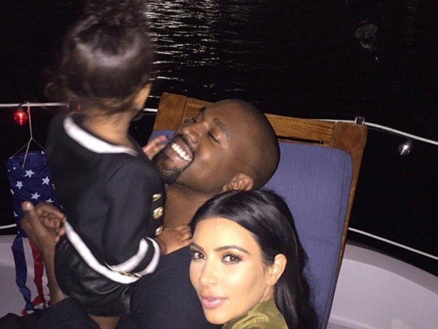 Kim Kardashian with Kanye West and North West in Instagram photo
