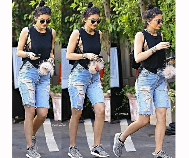 kylie jenner in blue denim cut off shorts