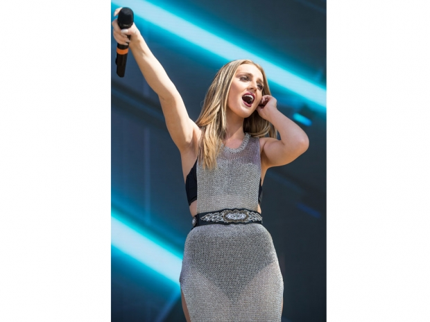 Perrie Edwards wearing a chain mail dress at the Billboard Hot 100 Music Festiva